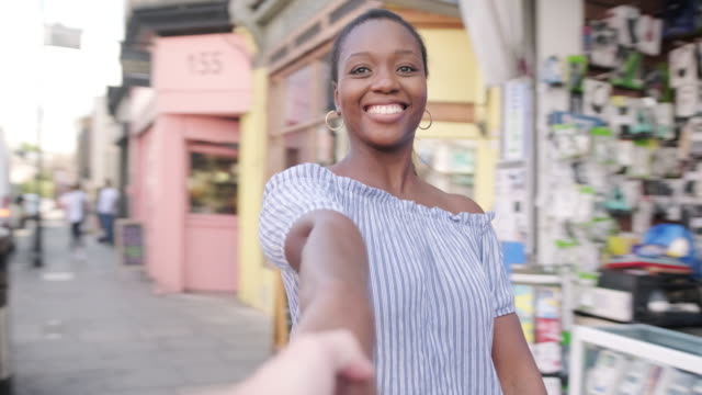 pov of a african american woman and caucasian man holding hands and whirling - personal perspective stock videos & royalty-free footage