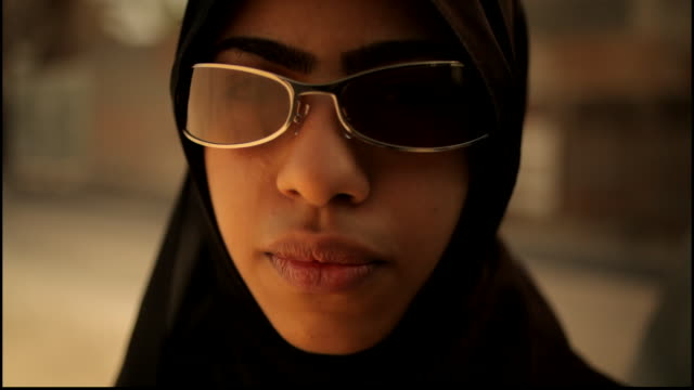of a bahraini woman wearing sunglasses smiling into the camera. - only girls stock videos & royalty-free footage