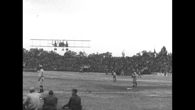 vs a biplane flies low over the baseball diamond at pershing stadium during the interallied games at which allied military personnel compete / note... - 1910 1919 stock videos & royalty-free footage