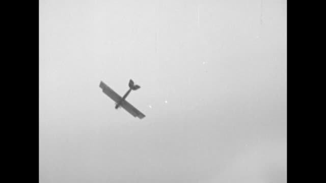 pov of a biplane with a stuntman seated on the top of the plane that does loops flies upside down and dives / note exact month/day not known - acrobatica aerea video stock e b–roll