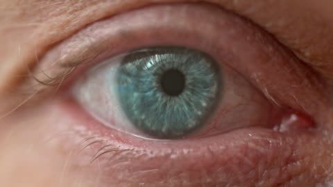 ecu of a blue eye opening - opening stock videos & royalty-free footage