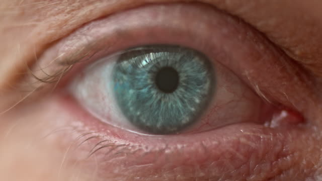ecu of a blue eye opening - eye stock videos & royalty-free footage