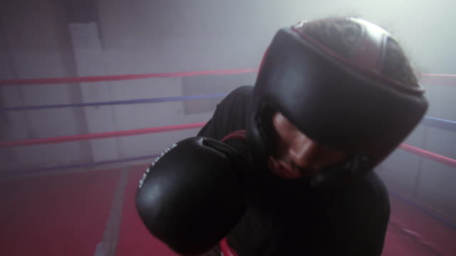 slo mo. pov of a boxer punching inside a boxing ring in a professional boxing gym - exhaustion stock videos & royalty-free footage
