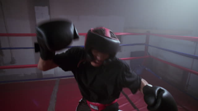 A boxer bobs and jabs during a training match.