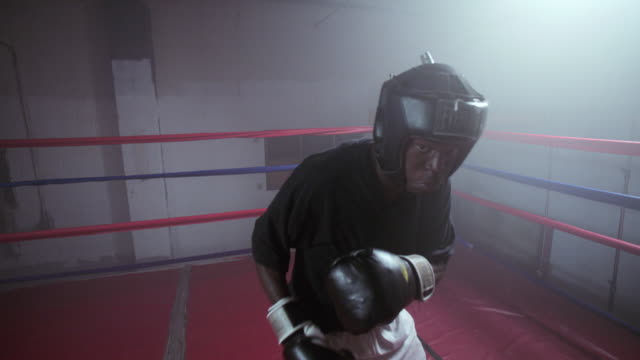 pov of a boxer punching inside a boxing ring in a professional boxing gym - beweglichkeit stock-videos und b-roll-filmmaterial