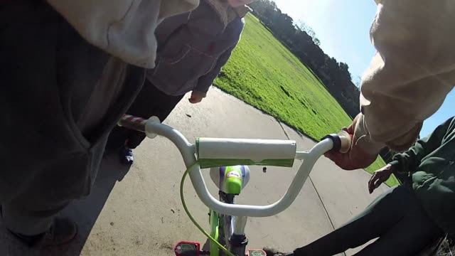 POV of a boy riding a bicycle at a park. - Model Released - 1920x1080 - HD