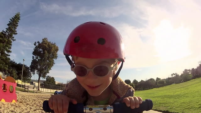 pov of a boy riding a scooter at a park. - model released - 1920x1080 - hd - helmet stock videos & royalty-free footage