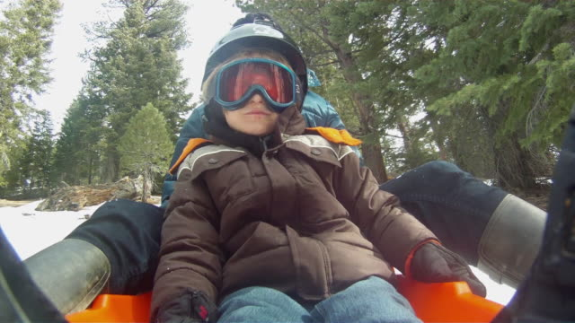 pov of a boy snow sledding on a mountain in winter. - slow motion - model released - 1920x1080 - hd - helmet stock videos & royalty-free footage