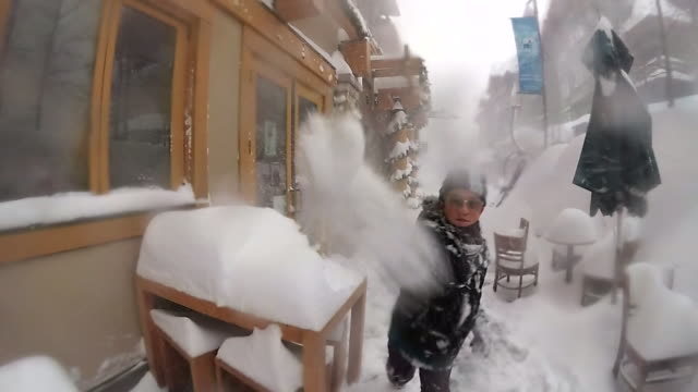 POV of a boy throwing snow at the camera. - Slow Motion