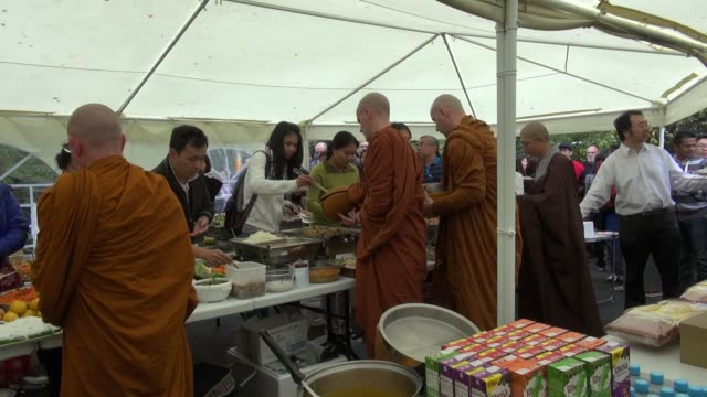 of a buddhist abbot, monks and a nun receiving food during the festival celebrating the end of vassa in the forest hermitage a buddhist retreat in... - theravada stock videos & royalty-free footage