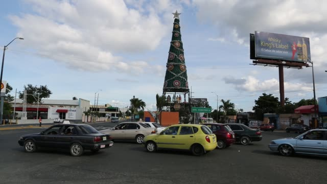 santo domingo dominican republic december 02 2012 ws of a busy traffic circle on ave venezuela in santo domingo with some christmas decoration a... - santo domingo dominican republic stock videos & royalty-free footage