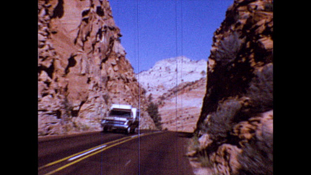 of a car driving through red rock canyon in nevada. - nevada stock videos & royalty-free footage