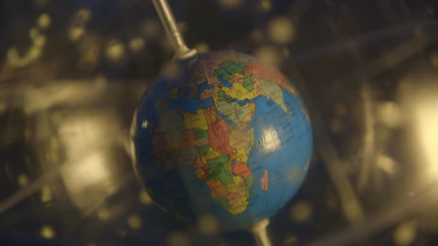cu of a celestial globe being spun - cartography stock videos & royalty-free footage