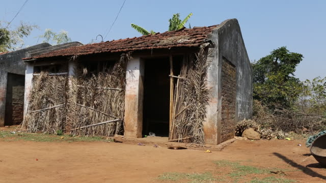 WS of a clay hut with a roof made of bricks and with in a rural area of the village Satia a small settlement 300 Kilometer from Kolkata India Palm...