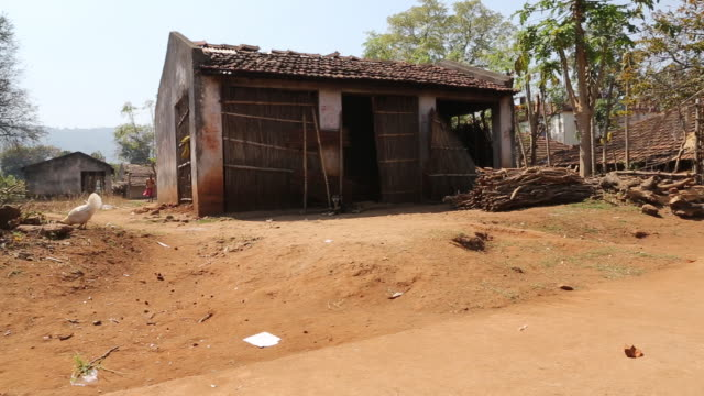 WS of a clay hut with a roof made of bricks and with in a rural area of the village Satia a small settlement 300 Kilometer from Kolkata India Farm...