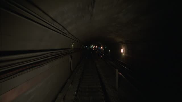 pov of a commuter train traveling quickly through a subway tunnel in new york city. - tunnel stock videos and b-roll footage