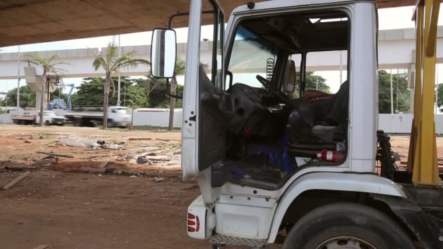 LS a construction worker sleeps in a truck cabin A homeless lady lives under a bridge that is being built for the FIFA 2014 World Cup and the 2016...