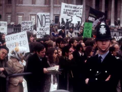 ts crowd in square av david sheppard speaking on dais ms crowd with banners listen behind barrier policeman in fig ms mockup fighter plane cms crowd... - apartheid stock videos & royalty-free footage