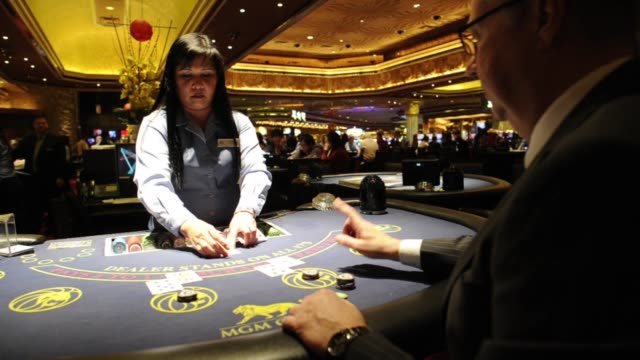 a dealer at the mgm resorts international plays a hand of blackjack with a customer in las vegas nevada / various angles of blackjack game blackjack... - blackjack stock videos and b-roll footage