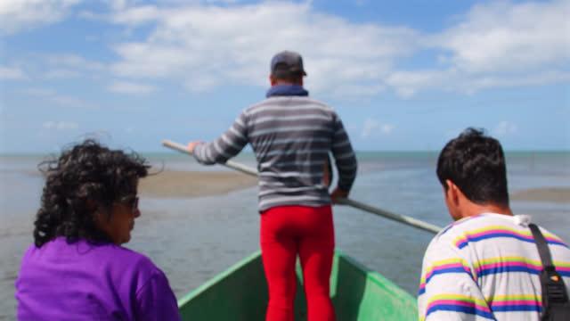 a defocused image of cuban fishermen leaving the coast of cuba towards the open sea on january 16, 2017; in tunas de zaza, sancti spiritus, cuba. the... - three people stock videos & royalty-free footage