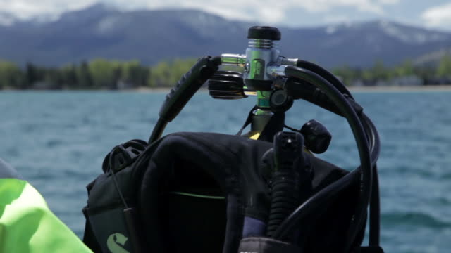 cu of a diving vest and regulator on lake tahoe - tauchgerät stock-videos und b-roll-filmmaterial