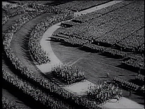stockvideo's en b-roll-footage met a documentary by frank capra of the nuremberg nazi party rally / germany - nazism