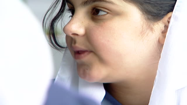 cu of a druze schoolgirl wearing a traditional headscarf or mandil attending an english class at irfan a druze religious school in the chouf mountains - religiöse kleidung stock-videos und b-roll-filmmaterial