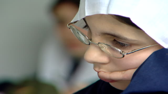 of a druze schoolgirl wearing a traditional headscarf or mandil, attending an english class at irfan, a druze religious school in the chouf mountains. - girls stock videos & royalty-free footage