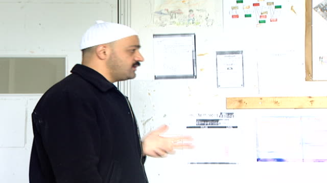 a druze teacher lecturing on citizen rights in a classroom of boys. irfan is a druze religious school with five branches in lebanon that operate as... - シャイフ点の映像素材/bロール