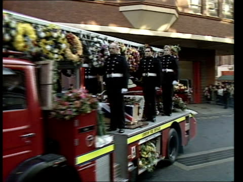 COLIN TOWNSLEY FUNERAL a ENGLAND Central London MS Red Watch firemen lining pavement outside Soho fire station PAN RL PAN RL more CMS Fireman PAN RL...