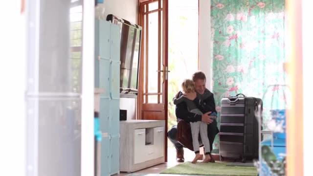 a father arrives home after a business trip. - homecoming stock videos & royalty-free footage