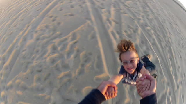POV of a father holding his son's hands and spinning him around on the beach at sunset. - Model Released - 1920x1080 - HD
