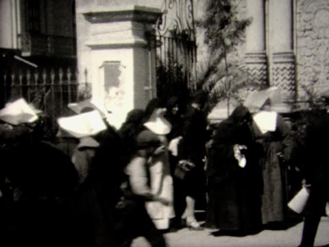 1928 a flock of nuns on a bolivian street - 1928 stock-videos und b-roll-filmmaterial