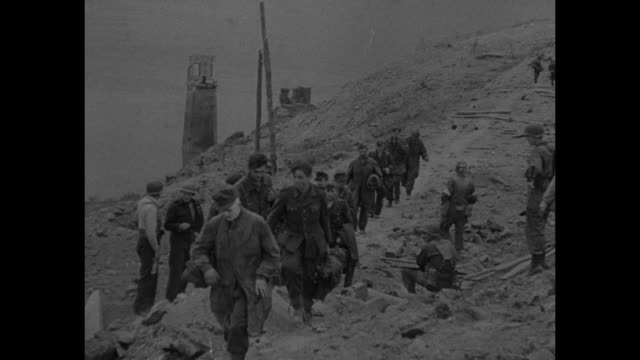 vs a german soldier with small cigar talks closely to american he's drunk and swaying nazis emerge from hole in rubble / line of german prisoners... - prigioniero di guerra video stock e b–roll