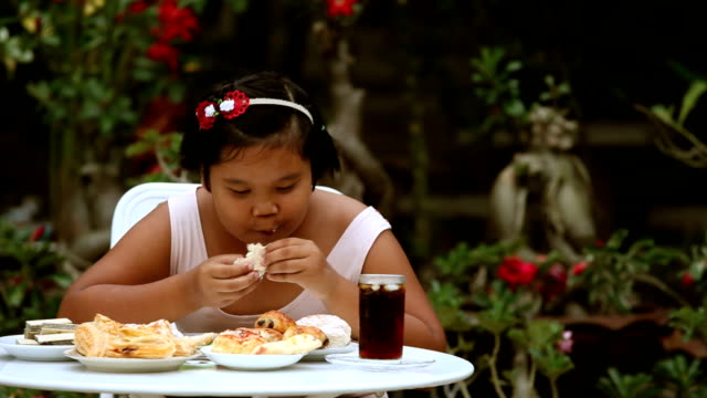 a girl eating - overweight stock videos and b-roll footage