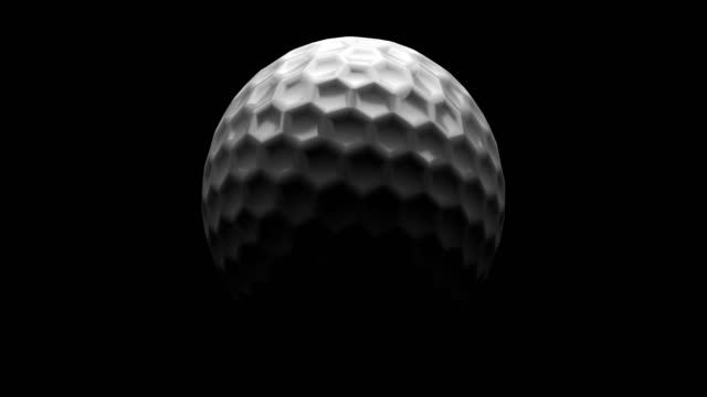 a golfball rotating loop isolated with luma matte - golf ball stock videos & royalty-free footage