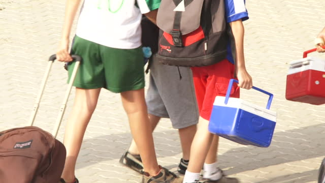 of a group of expat children with backpacks going to school. the children are from several nationalities and ethnicities. - schoolboy stock videos & royalty-free footage