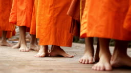 a group of monks walking