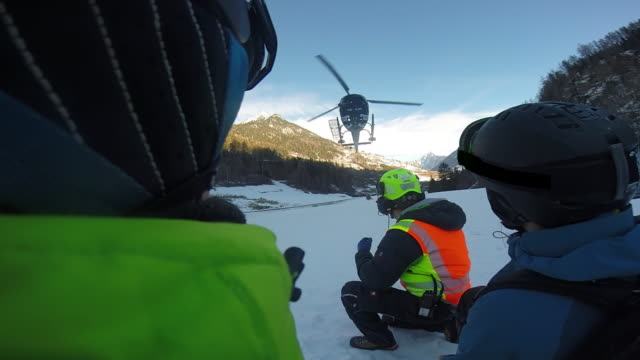 pov of a helicopter landing to pick up skiers for skiing in the mountains. - slow motion - helicopter landing stock videos & royalty-free footage