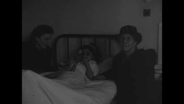 vs a hospital ward with many single beds with young children two women and a little girl with a bruised face a nurse turns pages of a book for an... - petworth stock videos and b-roll footage