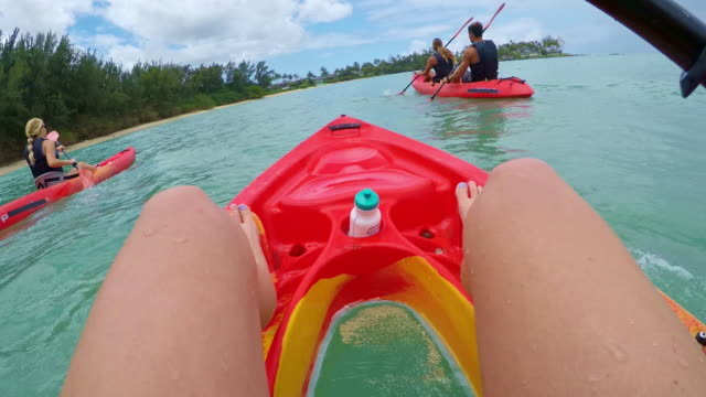 pov of a kayaker paddling in the ocean with three other people - turtle bay hawaii stock videos & royalty-free footage