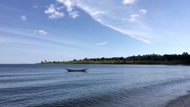 a lonely boat in lake victoria - egret stock videos & royalty-free footage