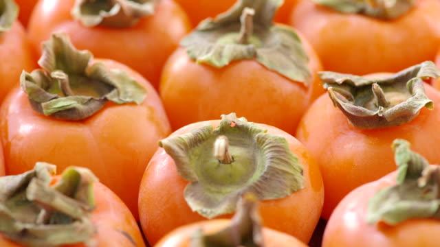 Um lote de maduro deliciosos Diospiros frutos