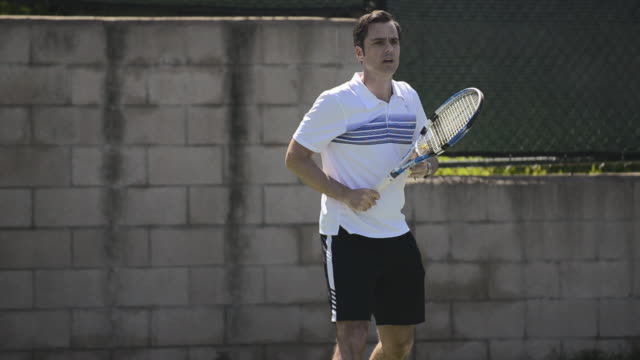 cu a male tennis player hitting the tennis ball forehand. - forehand stock videos & royalty-free footage