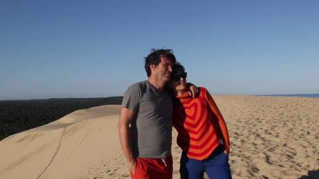 a man and a woman at summit of the pyla dune, a summer morning - arcachon stock videos & royalty-free footage