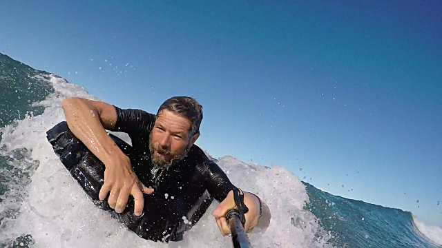 POV of a man bodysurfing on an inflatable surfmat. - Slow Motion