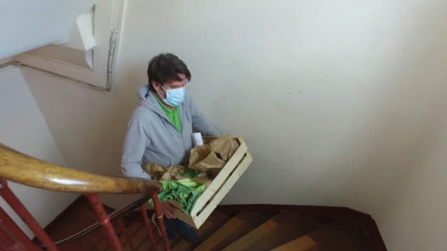 a man delivers fruits and vegetables, at home - fare spese video stock e b–roll