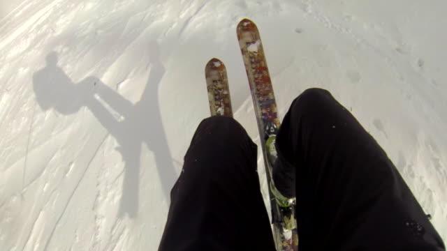 pov of a man downhill skiing. - slow motion - ski jacket stock videos & royalty-free footage