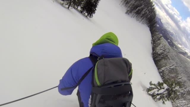 pov of a man downhill skiing. - time-lapse - skijacke stock-videos und b-roll-filmmaterial