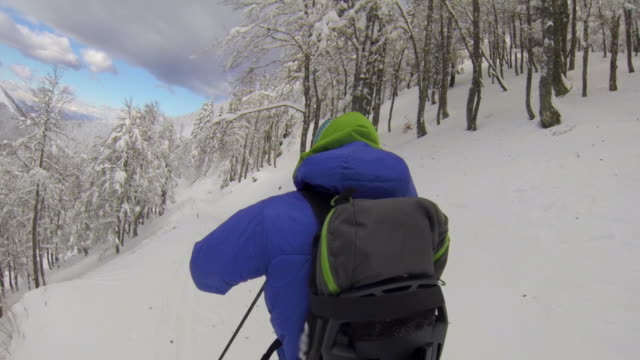 POV of a man downhill skiing. - Time-Lapse